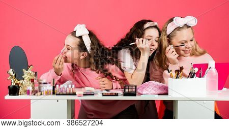 Cosmetics For Children. Kids Makeup. Happy Girls Doing Makeup Together. Beauty Salon. Play With Cosm