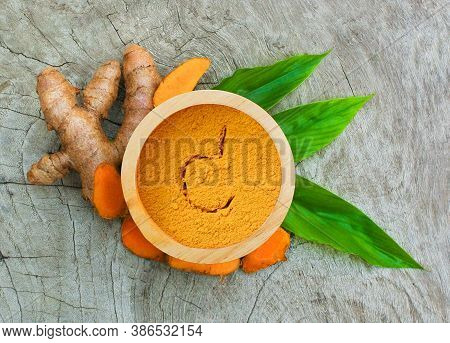 Turmeric Powder And Turmeric Root Isolated On Wood ,turmeric Is Herb,turmeric Vitamin C,vitamin C Fo