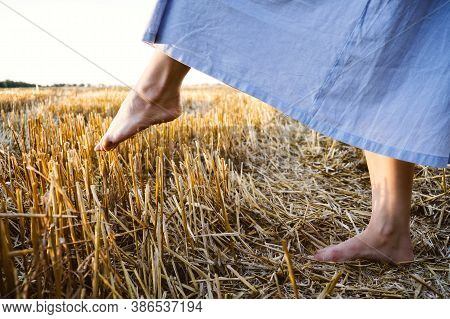 Overcome Obstacles Depression Concept. A Womans Bare Foot Makes A Step Over A Sharp Prickly Mown Str