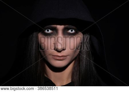 Mysterious Witch With Spooky Eyes On Black Background