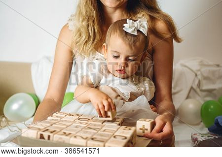 Little Girl Playing With Wooden Abc Blocks. Plastic-free Wooden Zero Waste Kids Toys For Safe And Su