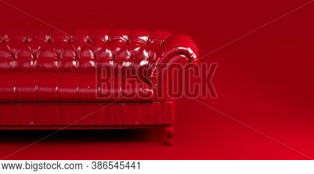 Red Quilted Leather Sofa On Red Background Front View. Creative Concept Of Minimalistic Interior, St