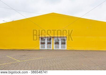 Light Trade Pavilion Made Of Yellow Tarpaulin