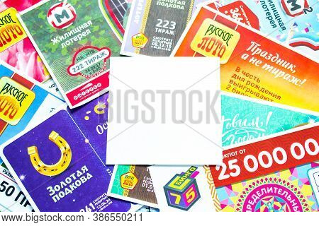 Moscow, Russia, July 2020: Various Russian Lottery Tickets With White Piece Of Paper For Text In The