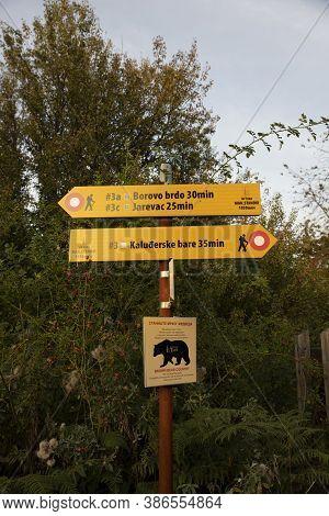 Tara Mountain, Serbia - September 16, 2020: Sign Post Depicting Hiking Trails And Bear Encounter War