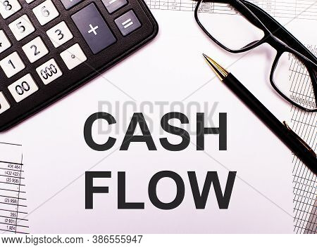 Cash Flow Is Written On White Paper Near A Calculator, Glasses And A Pen. Financial Concept