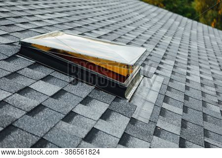 open roof window on shingles flat polymeric roof-tiles
