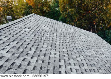 new renovated roof with shingles flat polymeric roof-tiles
