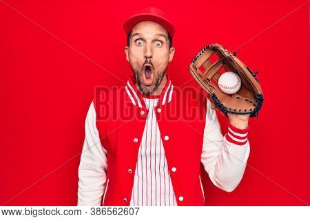 Young handsome player man wearing sportswear playing baseball using glove and ball scared and amazed with open mouth for surprise, disbelief face