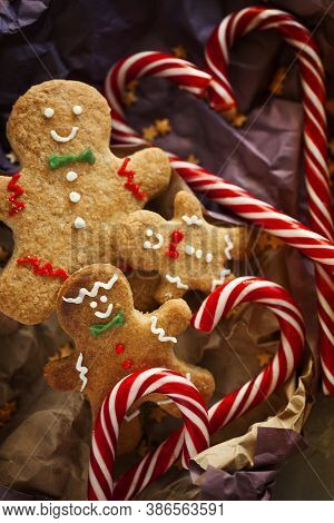Smiling Biscuits Gingerbread Man Cookies And Candy Cane Packed In Wrapping Paper For Gift Top View C