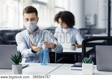 Rules For Safety Health During Coronavirus Outbreak. Man In Protective Mask Treat His Hands With Ant