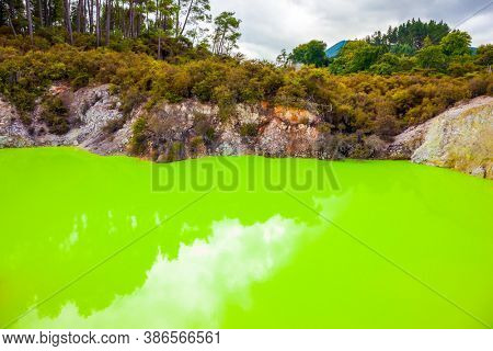 Devil's Bath with bright green color of water. Volcanic Valley Waimangu, Wai-O-Tapu. The unique geothermal area of Rotorua. New Zealand, North Island. Extreme, exotic and photo tourism concept