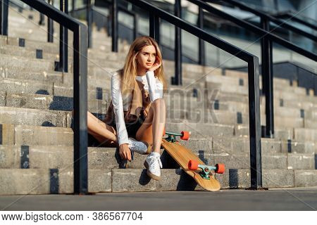 Beautiful Woman Skates Around The City. Lifestyle And Summer Vacation.