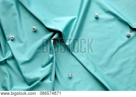 Ai Aqua - Trendy Color Of The Year 2021. Trendy Top View, Disco Balls On Mint Blue Textile.