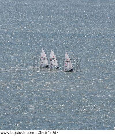 Portland Harbour, United Kingdom - July 3, 2020: High Angle Aerial Portrait Format Shot Of Three Las