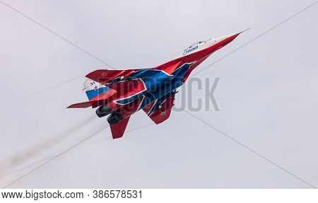 Barnaul, Russia - September 19, 2020: A Low Angle Close-up Shot Of Strizhi Mig-29 Fighter Jet Perfor
