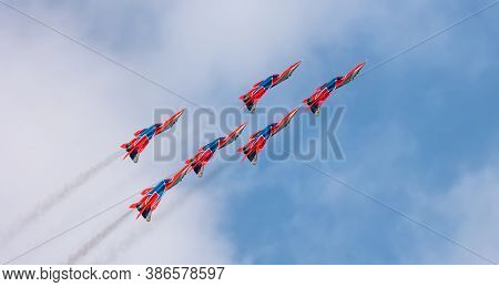 Barnaul, Russia - September 19, 2020: A Low Angle Shot Of Strizhi Mig-29 Fighter Jet Squadron Flying