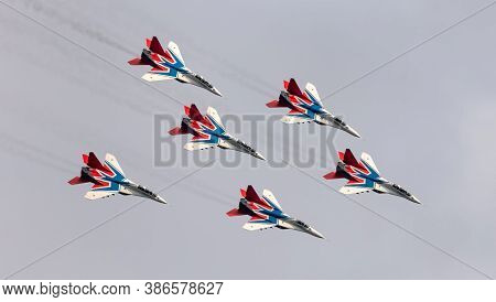 Barnaul, Russia - September 19, 2020: A Shot Of Strizhi Mig-29 Fighter Jet Squadron Performing Stunt