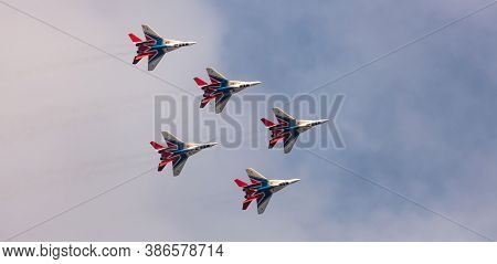 Barnaul, Russia - September 19, 2020: A Low Angle Shot Of Strizhi Mig-29 Fighter Jet Squadron Perfor