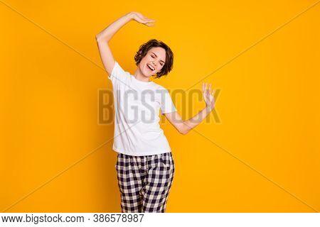 Portrait Of Cheerful Candid Girl Have Slumber Party Raise Hands Feel Rejoice Try Dance Wear Pyjama I