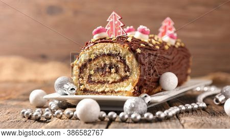 christmas chocolate swiss roll and decoration- chocolate yule log christmas cake