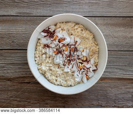 Oatmeal Porridge With Almonds, Coconut And Chocolate. Healthy Eating. Vegetarian Food. Breakfast. Di