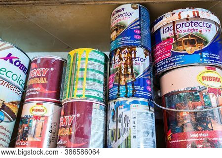 Miercurea Ciuc, Romania- 23 September 2020: Variety Of Used Paint Cans In A Small Woodworking Shop.