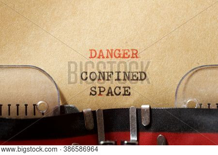Danger confined space phrase written with a typewriter.