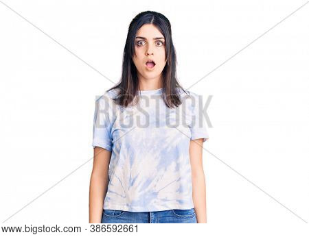 Young beautiful girl wearing casual t shirt afraid and shocked with surprise and amazed expression, fear and excited face.