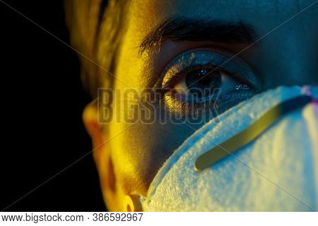 health, safety and pandemic concept - close up of young woman wearing protective mask or respirator over black background