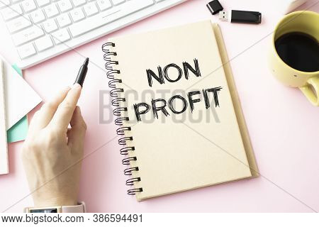 Red Pen And Notepad With Text Non Profit In The White Background