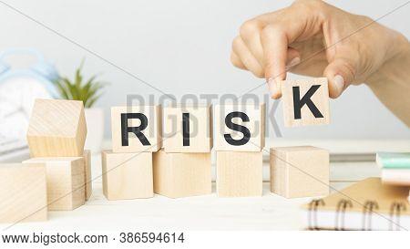 Risk Word Written On Wooden Cubes. Financial Risk Assessment, Risk Reward And Portfolio Risk Managem