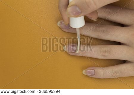 Application Of Colorless Nail Polish To Strengthen Nails