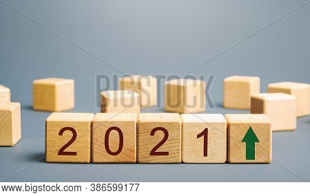 Wooden Blocks With The Inscription 2021 And An Up Arrow. The Forecast Concept For 2021. Business For