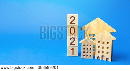 2021 Wooden Blocks And Miniature House. Real Estate Concept. Family Budget Planning. Investments, Pl