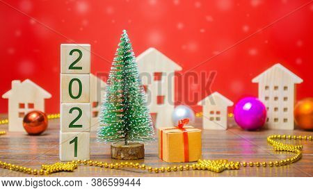Wooden Blocks 2021, Christmas Tree, Miniature Houses And Gifts. New Year Or Xmas Winter Holiday. Dec