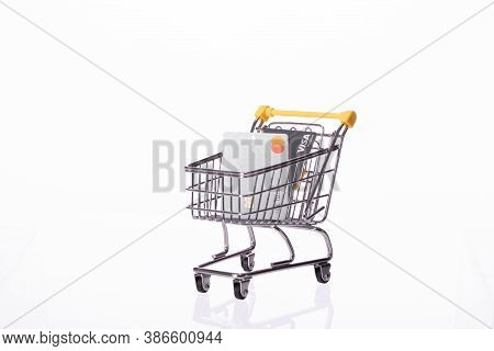 Ny, Usa - August 25, 2020: Two Credit Cards Visa And Mastercard In Shopping Cart Isolated On White B