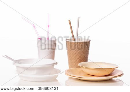 Plastic Vs Natural Materials Isolated On White Background. Craft Paper Eco-friendly Tableware Agains