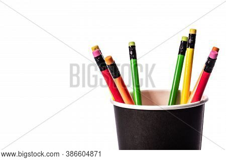 Close Up View Colored Pencils In Black Paper Glass Isolated On White Background. School, Office, Pre
