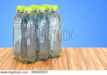 Water Bottles Wrapped In The Shrink Film On The Wooden Table. 3d Rendering