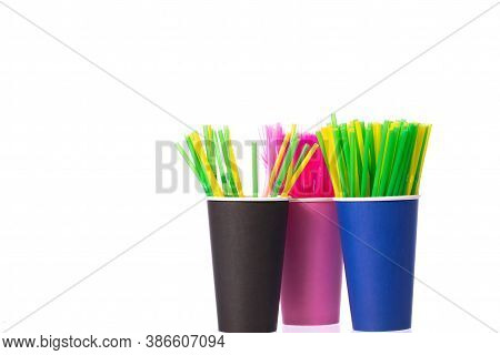 Three Disposable Biodegradable Paper Cups With Multi Colored Plastic Straws Isolated On White Backgr
