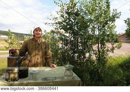 Nurse In Quilted Jacket With Teapot