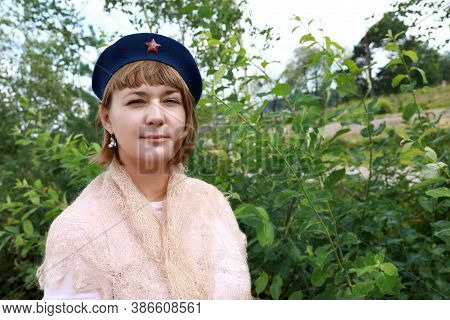 Woman In Military Beret In Park