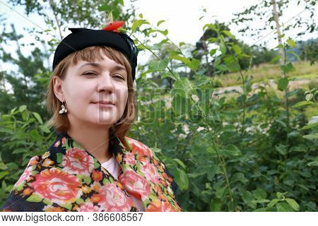 Woman In Old-fashioned Clothes In Park
