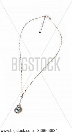 Women`s Silver Chain Necklace Gemstone Pendant On White Background. Close-up Shot
