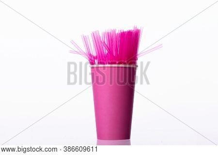 Pink Plastic Flexible Straws In Disposable Paper Cup Isolated On White Background. Cafe Drinks, Fema