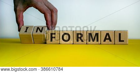 Male Hand Flips Wooden Cubes And Change The Inscription 'formal' To 'informal'. Beautiful Yellow Tab