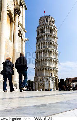Pisa, Italy - March 17, 2012: People Taking Photo Near The Tower Of Pisa (torre Di Pisa).