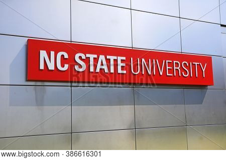 RALEIGH, NC, USA - SEPTEMBER 04, 2020 : Main Entrance Sign on shiny wall at North Carolina State University in Raleigh, North Carolina. It is largest university in both North and South Carolina.