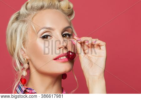 Young Pin-up Woman With Make Up Eating Cherry, Close Up Portrait